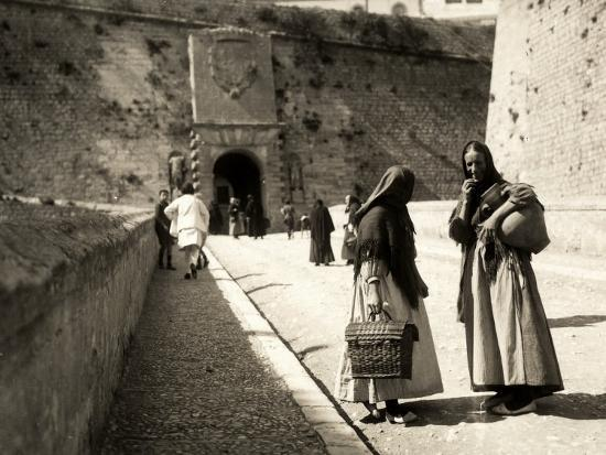 the-ramp-which-leads-to-the-old-city-in-ibiza-with-two-women-in-the-foreground