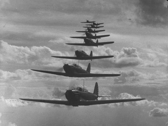 thomas-d-mcavoy-nine-army-air-corps-bi-place-pursuit-planes-flying-in-formation-with-a-maximum-speed-of-300-m-p-h