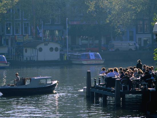 thomas-winz-outdoor-cafe-on-canal-amsterdam-north-holland-netherlands