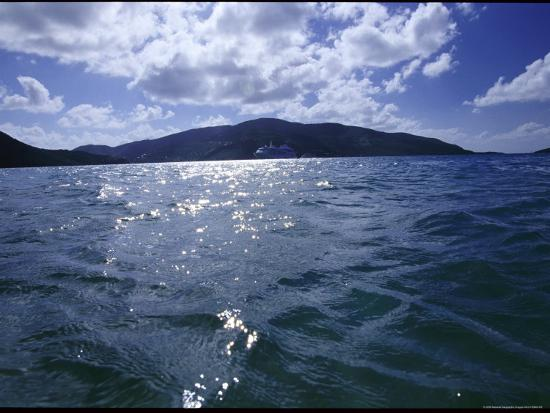 todd-gipstein-a-cruise-ship-sails-past-an-island