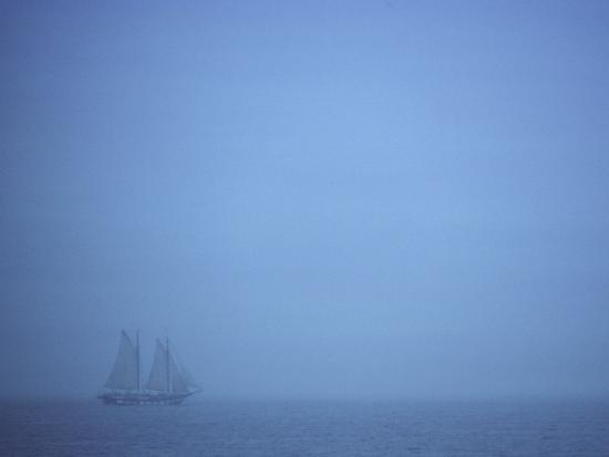 todd-gipstein-a-schooner-ship-sails-through-dense-fog-off-the-coast-of-new-england
