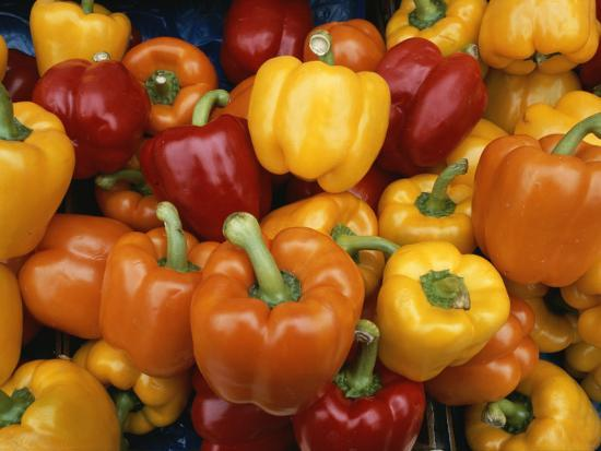 todd-gipstein-red-orange-and-yellow-bell-peppers-on-display-in-a-venice-market