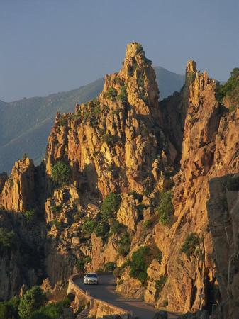 tomlinson-ruth-calanche-white-granite-rocks-with-car-on-road-below-near-piana-corsica-france-europe