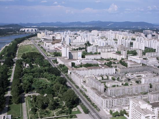 tony-waltham-blocks-of-flats-beside-taedong-river-park-and-distant-mayday-stadium-pyongyang-north-korea