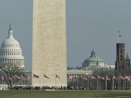 tourists-and-flags-surrounding-the-base-of-the-washington-monument