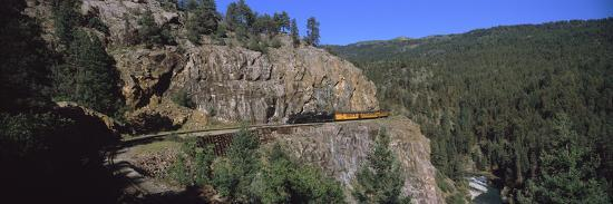 train-moving-on-a-railroad-track-durango-and-silverton-narrow-gauge-railroad-silverton-san-ju