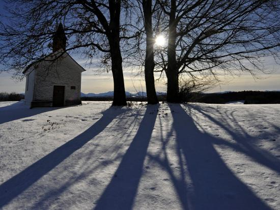 trees-cast-their-shadows-next-to-the-chapel-near-feldkirchen-southern-germany