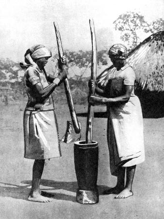 two-mashona-tribeswomen-pounding-maize-and-millet-zimbabwe-africa-1936