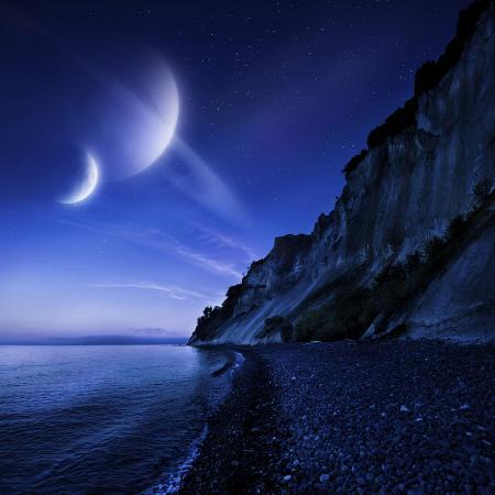 two-planets-hover-over-a-tranquil-sea-and-mons-klint-cliffs-denmark