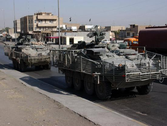 u-s-army-soldiers-patrolling-in-stryker-armored-wheeled-vehicles-as-part-of-operation-block-party