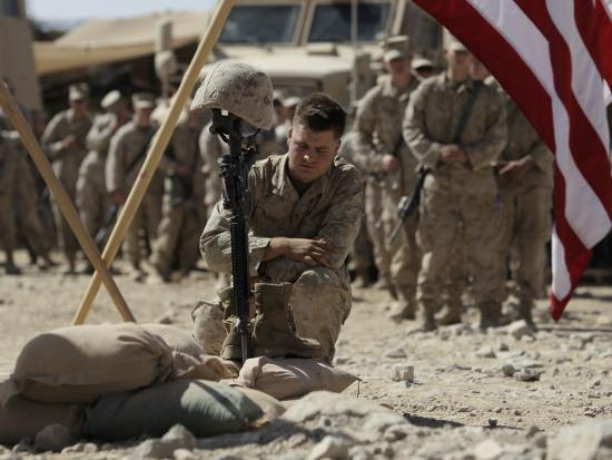 us-marine-pays-his-respects-to-lcpl-joshua-bernard-during-a-memorial-service-at-base-in-afghanistan