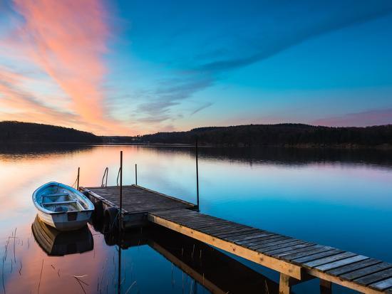 utterstroem-photography-boat-near-pier-over-a-idyllic-lake
