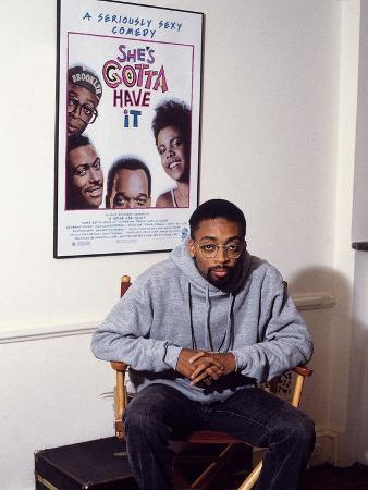 vandell-cobb-filmmaker-spike-lee-seated-in-front-of-a-poster-of-his-film-she-s-gotta-have-it-1986