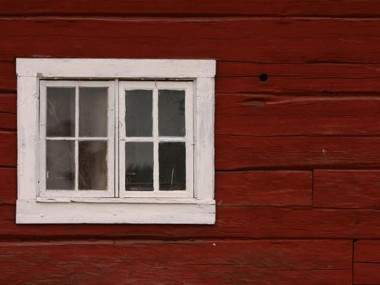 vibrant-red-painted-barn-wall-with-white-window