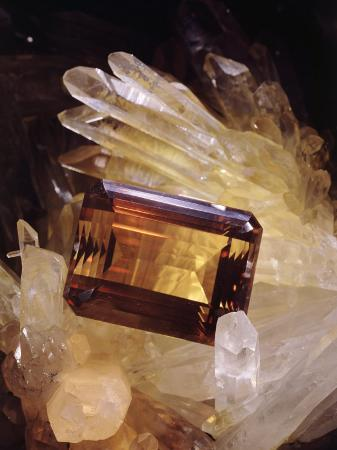 victor-r-boswell-jr-citrine-resting-on-a-crystal