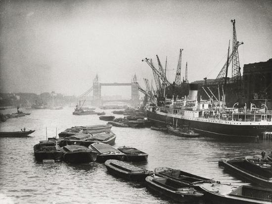 view-of-the-busy-thames-looking-towards-tower-bridge-london-c1920