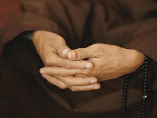 w-e-garrett-close-view-of-a-monks-hands-crossed-in-prayer