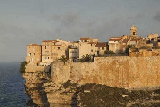 walter-bibikow-cliffside-houses-at-dawn-bonifacio-corsica-france