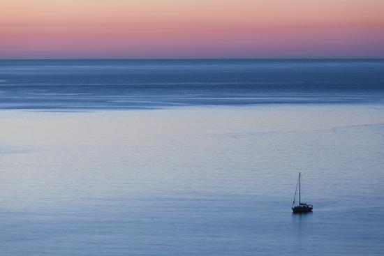 walter-bibikow-elevated-port-view-at-dusk-st-florent-le-nebbio-corsica-france