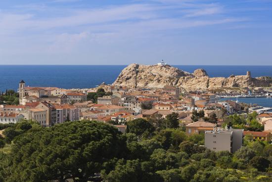 walter-bibikow-elevated-view-of-city-ile-de-la-pietra-ile-rousse-corsica-france