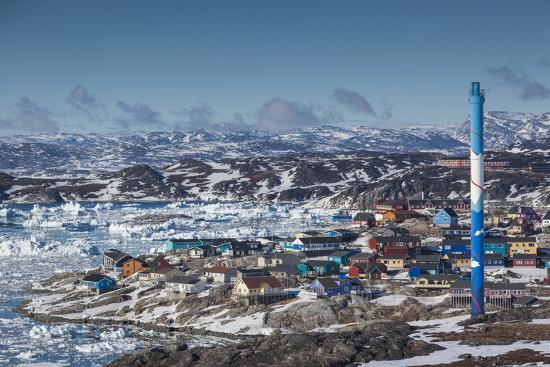 walter-bibikow-greenland-disko-bay-ilulissat-elevated-town-view-with-floating-ice