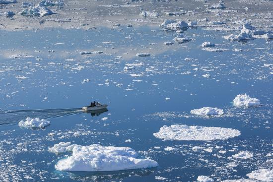 walter-bibikow-greenland-disko-bay-ilulissat-elevated-view-of-floating-ice-and-fishing-boat