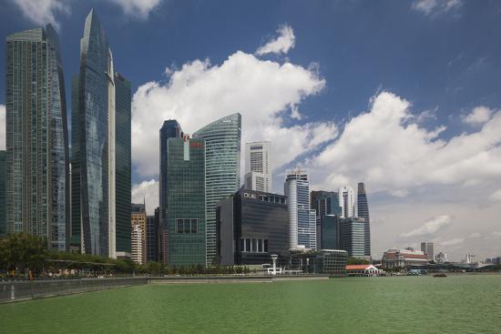 walter-bibikow-singapore-city-skyline-by-the-marina-reservoir