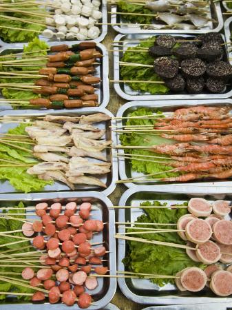 walter-bibikow-snacks-at-outdoor-grill-stand-old-town-lijiang-yunnan-province-china