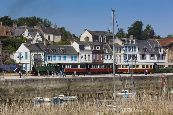 walter-bibikow-town-view-with-tourist-train-somme-bay-le-crotoy-picardy-france