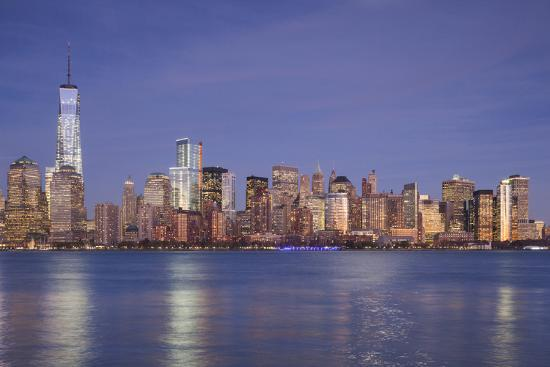 walter-bibikow-usa-new-york-new-york-city-lower-manhattan-and-freedom-tower-dusk