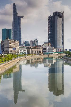 walter-bibikow-vietnam-ho-chi-minh-city-city-view-with-bitexco-tower-along-the-ben-nghe-canal