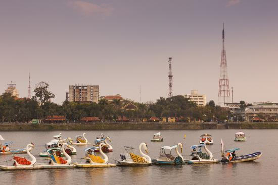 walter-bibikow-vietnam-hue-perfume-river-and-tourist-swan-boats-sunset