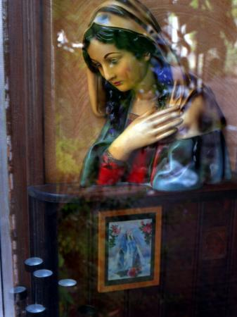 winfred-evers-bust-of-maria-viewed-through-window