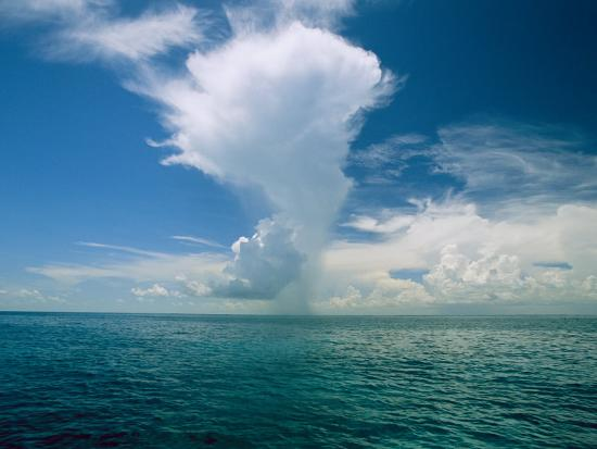 wolcott-henry-dramatic-clouds-over-calm-blue-pacific-ocean-waters