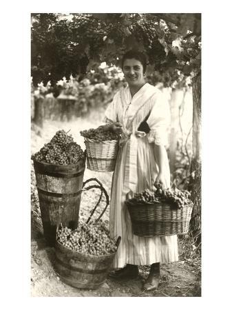 woman-carrying-baskets-of-grapes