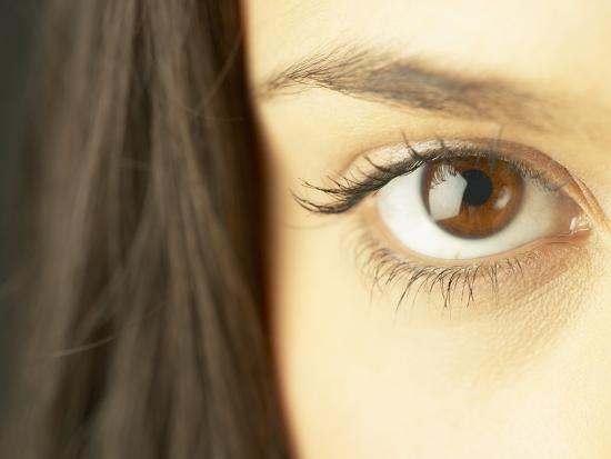 woman-s-brown-eye