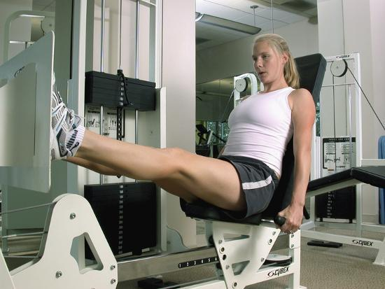 woman-working-out-on-a-weight-machine
