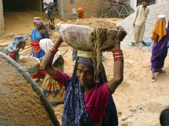 women-construction-workers-prepare-concrete-at-a-site-for-a-multiplex-complex