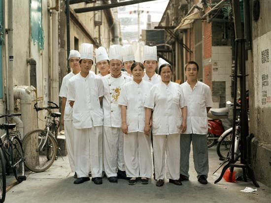 Restaurant Kitchen Staff chinese kitchen staff stand at attention outside a restaurant