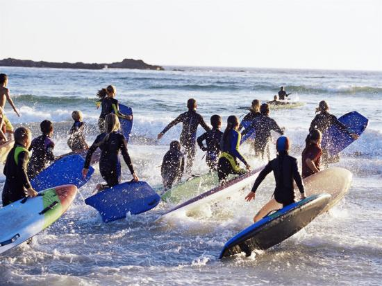 yadid-levy-teenage-surfers-running-with-their-boards-towards-the-water-at-a-life-saving-competition