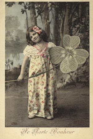 young-girl-holding-giant-four-leaf-clover
