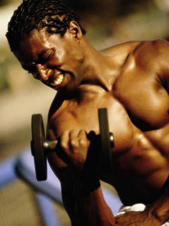 young-man-exercising-with-a-dumbbell