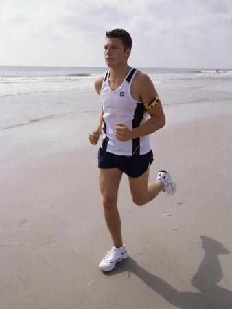 young-man-jogging-on-the-beach