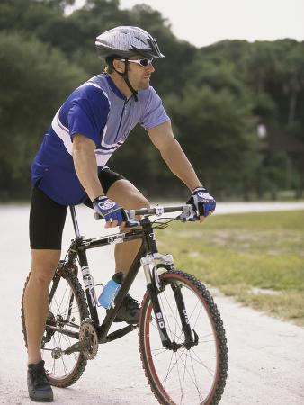 young-man-sitting-on-a-bicycle