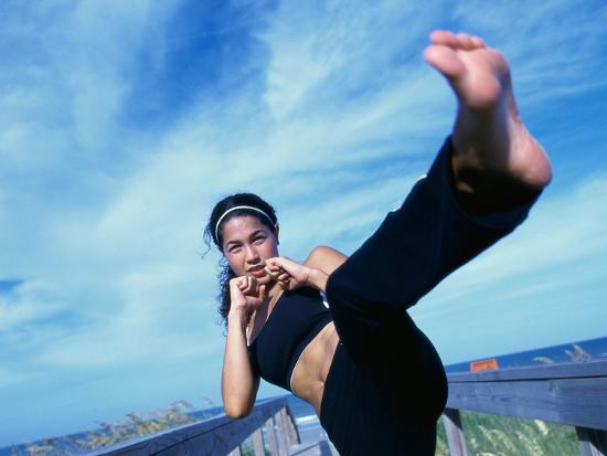 young-woman-kickboxing