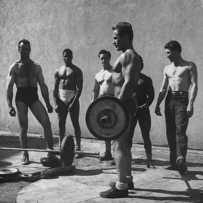 Prisoners at San Quentin Weightlifting in Prison Yard During Recreation Period-Charles E^ Steinheimer-Photographic Print