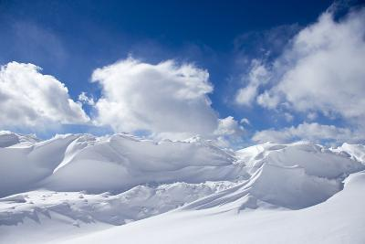 Pristine Snow Drifts Meet Large Puffy Clouds-Robbie George-Photographic Print