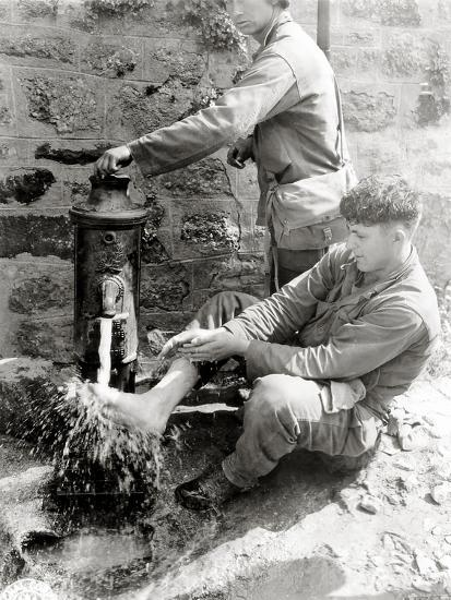 Private C. L. Scott of the 4th Infantry Division Is Washing His Feet at a Public Fountain--Photographic Print