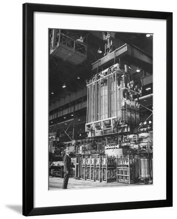 Prod Man George Hiser Watching as Completed Transformer Is Lowered into at General Electric Plant--Framed Photographic Print