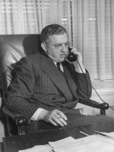 Producer David O. Selznick Sitting at His Desk, Talking on the Phone